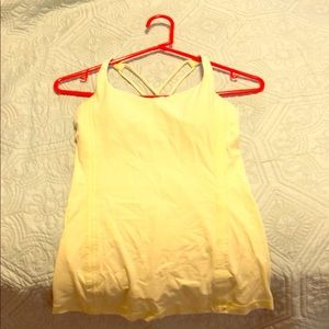 Lululemon top. Size 4 yellow and white stripes.